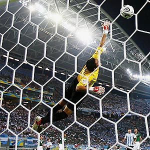Soccer Goalie Drills - goalkeeper leaping with large crowd