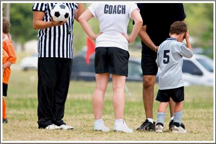 Soccer parents - soccer dad and son with coach
