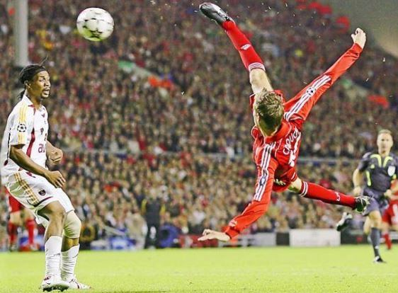 Famous player - Footballer flying through air